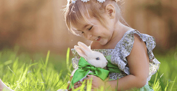 child playing with a Rabbit
